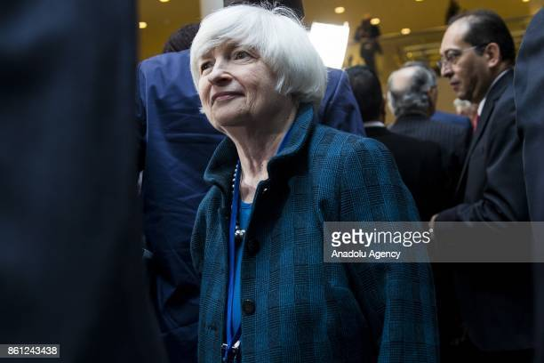 Chair of the US Federal Reserves Janet Yellen leaves after the Board of Governors Family Photo during the 2017 IMF and World Bank Annual Meetings in...