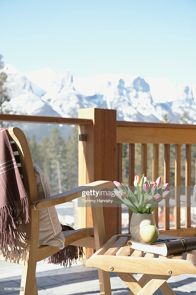 Chair on chalet balcony : Stockfoto