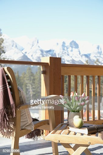 Chair on chalet balcony : Stock-Foto