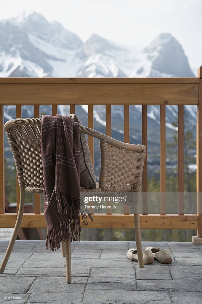 Chair on chalet balcony : ストックフォト
