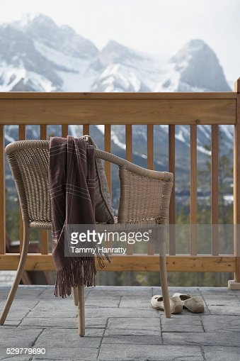 Chair on chalet balcony : Bildbanksbilder
