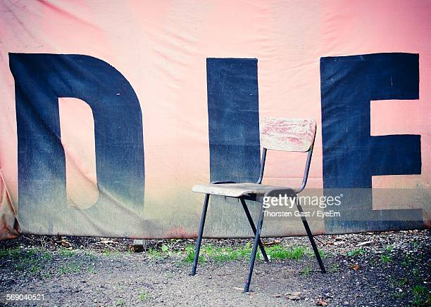 Chair On Field By Poster