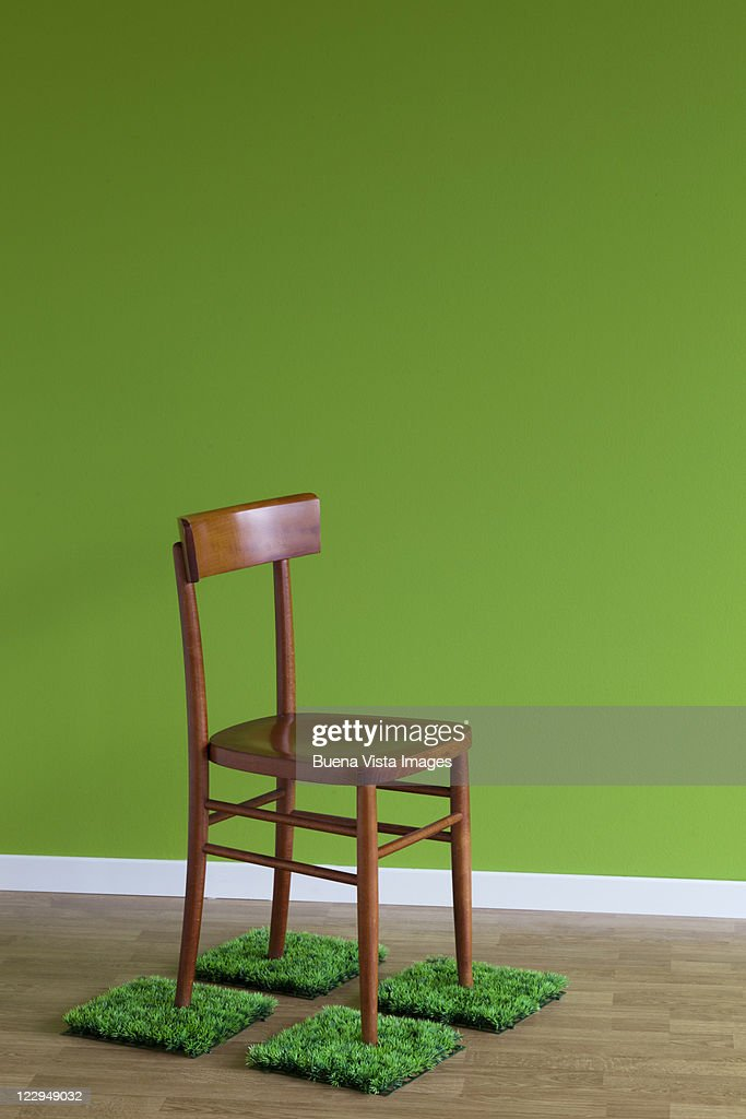 Chair over plastic grass : Stock Photo