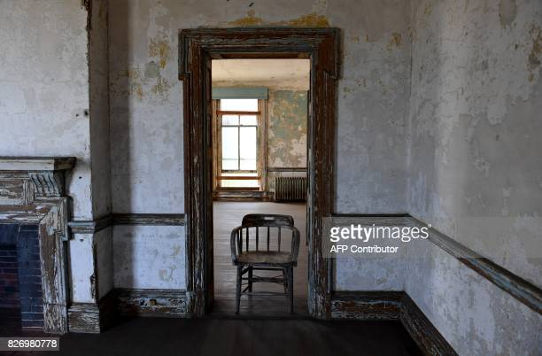 A chair sits in a room in one of the buildings of the The Ellis Island Hospital on August 5 a 750bed facility which treated over 12 million patients...