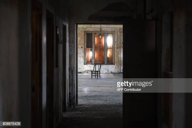 A chair sits in an empty room in one of the buildings of the The Ellis Island Hospital on August 5 a 750bed facility which treated over 12 million...