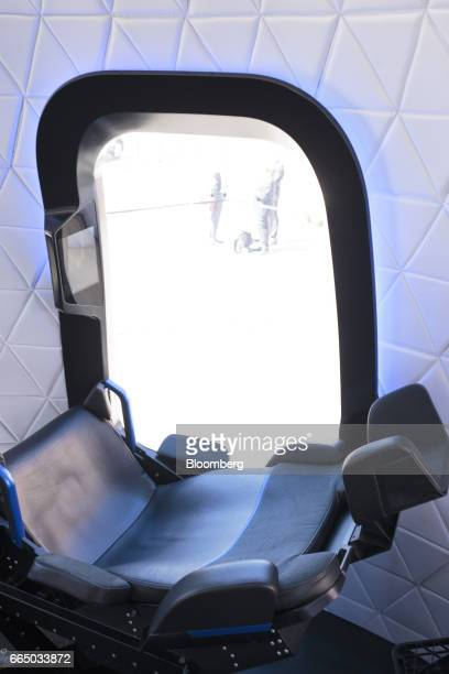 A chair sits inside the high fidelity crew capsule mock up of the Blue Origin LLC New Shepard system during the Space Symposium in Colorado Springs...