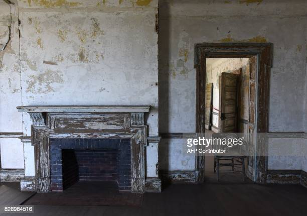 A chair stands in a room in one of the buildings of the The Ellis Island Hospital on August 5 a 750bed facility which treated over 12 million...