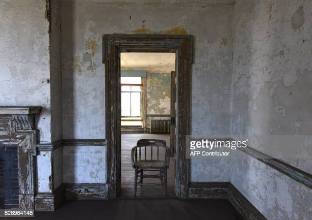A chair stands inside a room in one of the buildings of the The Ellis Island Hospital on August 5 a 750bed facility which treated over 12 million...
