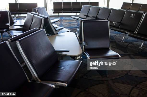 A chair that exists for people sitting at the airport.