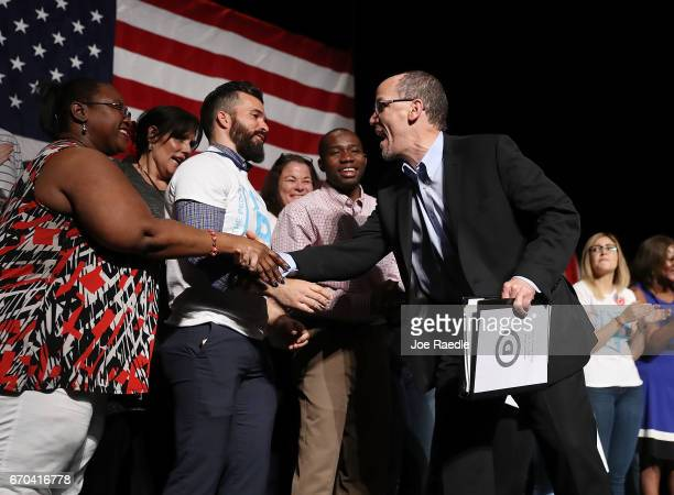 Chair Tom Perez greets people before speaking during a 'Come Together and Fight Back' tour at the James L Knight Center on April 19 2017 in Miami...