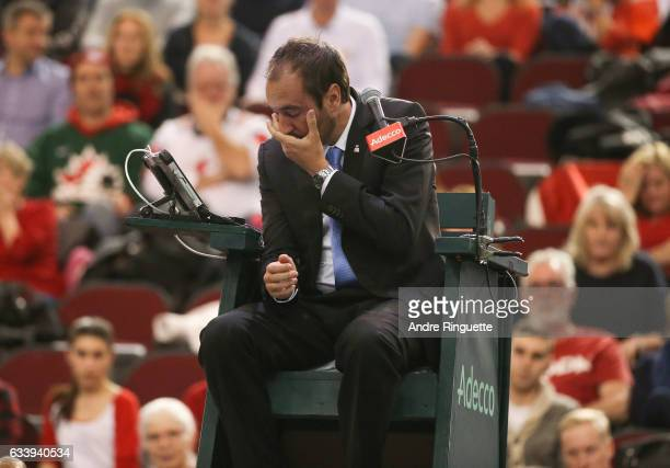 Chair umpire Arnaud Gabas reacts to getting hit in the eye with a ballbhit by Denis Shapovalov of Canada during the singles match between Kyle Edmund...