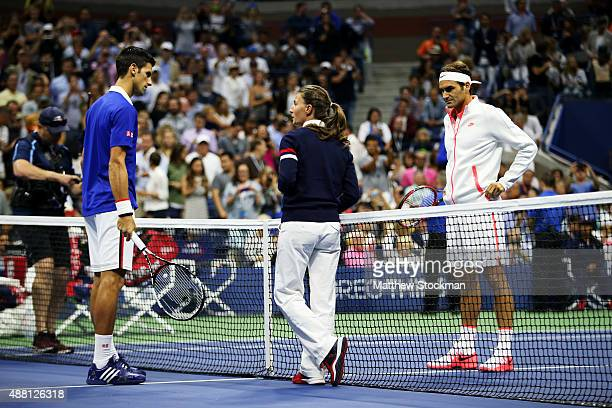 Chair Umpire Eva AsderakiMoore talks to Roger Federer of Switzerland and Novak Djokovic of Serbia prior to the Men's Singles Final match on Day...