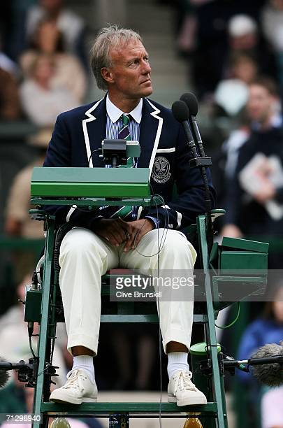 Chair umpire Gerry Armstrong looks up at the weather before calling the match between Roger Federer of Switzerland and Richard Gasquet of France...