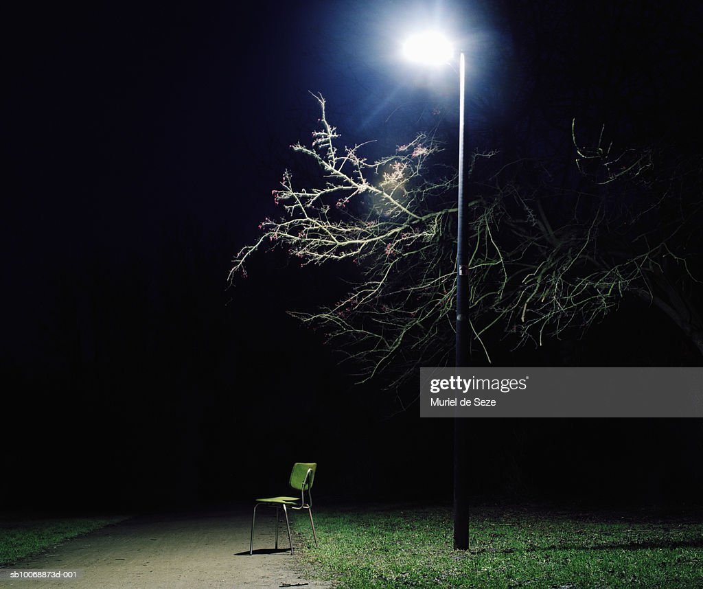 Chair under street light in park at night : Stock Photo