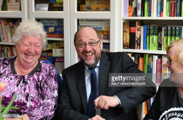 SPD chairman and candidate for Chancellery Martin Schulz smiles during a visit to a mixed generation housing project on March 29 2017 in Teltow near...
