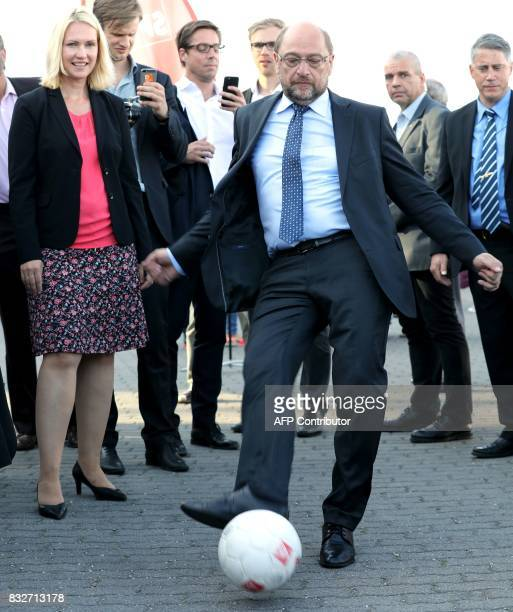 Chairman and candidate for Chancellor Martin Schulz kicks a football during an election campaign event of the Social Democratic Party in Stralsund...