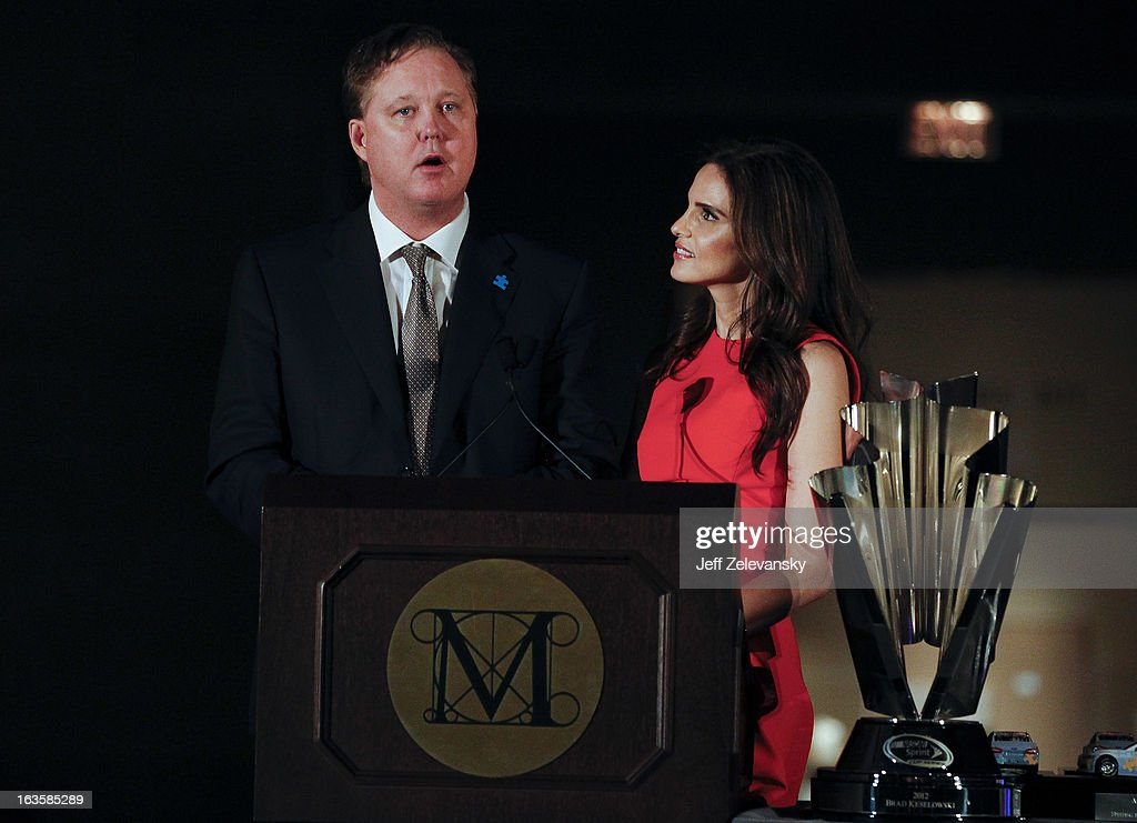 Chairman and CEO <a gi-track='captionPersonalityLinkClicked' href=/galleries/search?phrase=Brian+France&family=editorial&specificpeople=675720 ng-click='$event.stopPropagation()'>Brian France</a> and wife Amy speak to guests at 'Speeding For A Cure', a gala to benefit Autism Speaks held at the Metropolitan Museum of Art on March 12, 2013 in New York City.