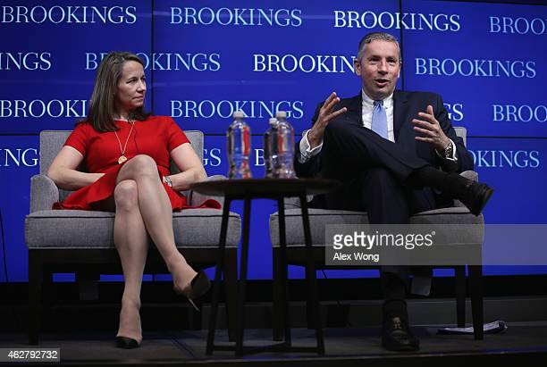 Chairman and CEO of Alcoa Klaus Kleinfeld speaks as CEO of Editas Medicine Katrina Bosley listens during a panel discussion of a forum at Brookings...