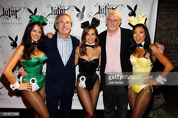 Chairman and CEO of American Media David Pecker and the New York Post finance columnist Keith Kelly pose for a photo with playboy bunnies Pennelope...