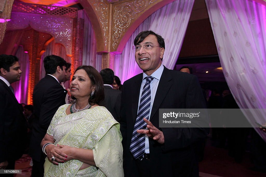 Chairman and CEO of ArcelorMittal Lakshmi Niwas Mittal with his wife Usha Mittal attending the marriage reception of YES Bank founder Rana Kapoor's daughter at Taj Palace on November 30, 2012 in New Delhi, India. Kapoor is the MD & CEO of YES Bank, which is the 4th largest private sector bank in the country.