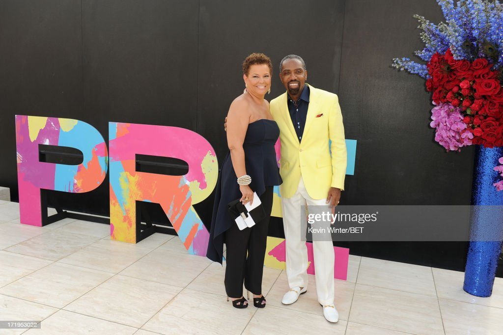 Chairman and CEO of BET Networks Debra Lee (L) and Louis Carr, President of Broadcast Media Sales for BET Networks attend Debra Lee's Pre-BET Awards Celebration Dinner at Milk Studios on June 29, 2013 in Los Angeles, California.