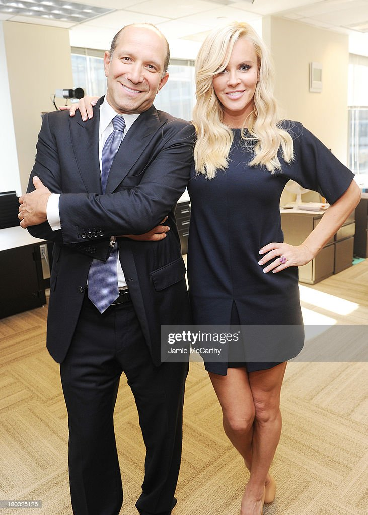 Chairman and CEO of Cantor Fitzgerald Howard Lutnick and model Jenny McCarthy attend the annual charity day hosted by Cantor Fitzgerald and BGC at the BGC office on September 11, 2013 in New York City.