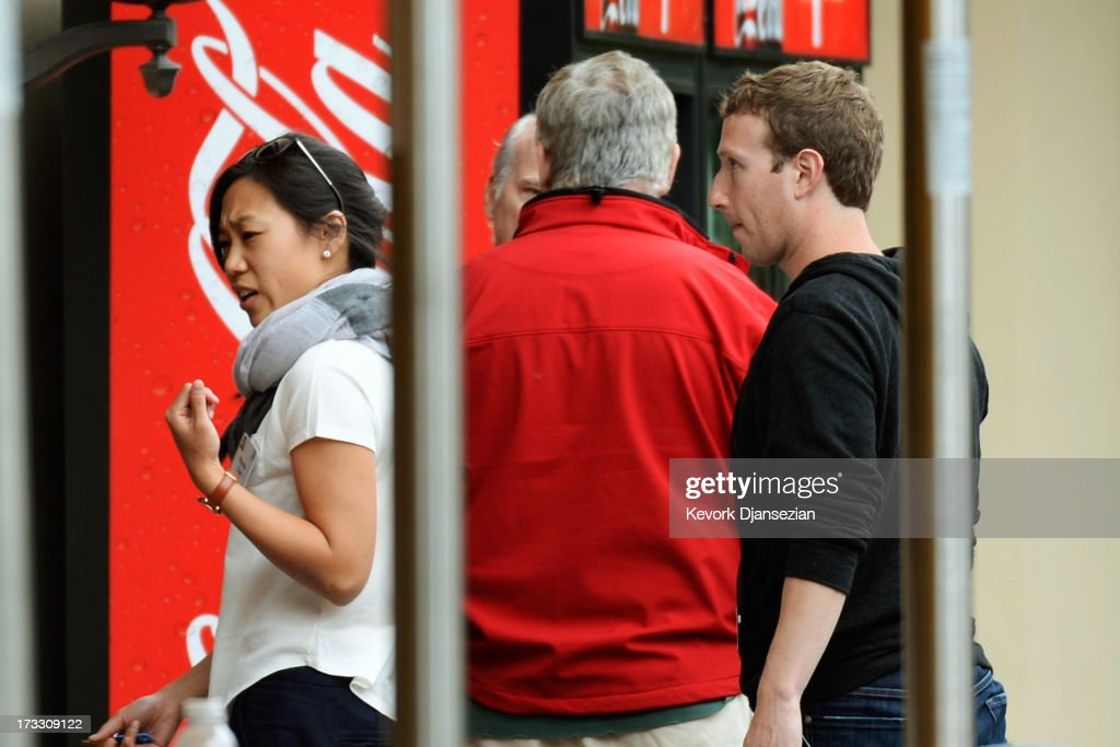 Chairman and CEO of Facebook <a gi-track='captionPersonalityLinkClicked' href=/galleries/search?phrase=Mark+Zuckerberg&family=editorial&specificpeople=4841191 ng-click='$event.stopPropagation()'>Mark Zuckerberg</a> (R) follows his wife <a gi-track='captionPersonalityLinkClicked' href=/galleries/search?phrase=Priscilla+Chan&family=editorial&specificpeople=4125446 ng-click='$event.stopPropagation()'>Priscilla Chan</a> after lunch during the Allen & Co. annual conference at the Sun Valley Resort on July 11, 2013 in Sun Valley, Idaho. The resort is hosting corporate leaders for the 31st annual Allen & Co. media and technology conference where some of the wealthiest and most powerful executives in media, finance, politics and tech gather for weeklong meetings. Past attendees included Warren Buffett, Bill Gates and <a gi-track='captionPersonalityLinkClicked' href=/galleries/search?phrase=Mark+Zuckerberg&family=editorial&specificpeople=4841191 ng-click='$event.stopPropagation()'>Mark Zuckerberg</a>.