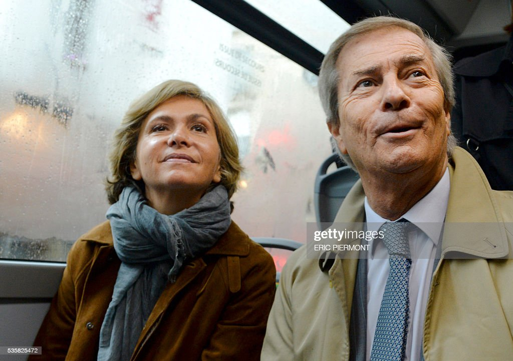 Chairman and CEO of French industrial group Bollore Group Vincent Bollore and President of the Ile-de-France Region Valerie Pecresse sit in the electric bus 'Bluebus' of the RATP (state-owned public transport operator responsible for most of the public transport in Paris) on May 30, 2016 place de l'Etoile in Paris during the official launch of the first '100% electric' 341 line between Clignancourt, northern Paris, and place de l'Etoile. / AFP / ERIC