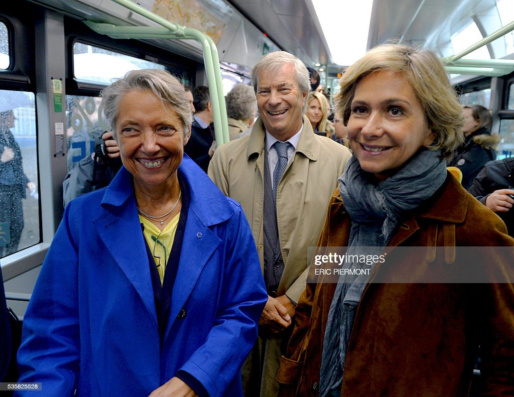 Chairman and CEO of French industrial group Bollore Group Vincent Bollore (C), President of the Ile-de-France Region Valerie Pecresse Chairwoman (R) and CEO of French RATP public transport operator Elisabeth Borne stand in the electric bus 'Bluebus' of the RATP (state-owned public transport operator responsible for most of the public transport in Paris) on May 30, 2016 place de l'Etoile in Paris during the official launch of the first '100% electric' 341 line between Clignancourt, northern Paris, and place de l'Etoile. / AFP / ERIC