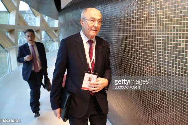 Chairman and CEO of French multinational industrial gas company Air Liquide Benoit Potier walks during the One Planet Summit on December 12 2017 at...