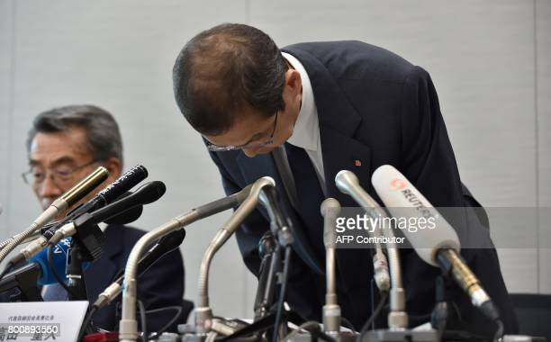 Chairman and CEO of Japanese airbag maker Takata Corp Shigehisa Takada bows as he attends a press conference in Tokyo on June 26 2017 Japan's...
