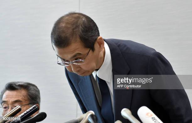 Chairman and CEO of Japanese airbag maker Takata Corp Shigehisa Takada bows at the beginning of a press conference in Tokyo on June 26 2017 Japan's...