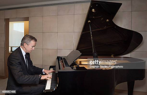 Chairman and CEO of LVMH Bernard Arnault is photographed for Le Figaro Magazine on October 1 2014 playing the piano in his office in Paris France...