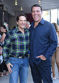 Chairman and CEO of Mandalay Entertainment Peter Guber and Tony Robbins attend the celebration of the release of Joe Berlinger / Tony Robbins...