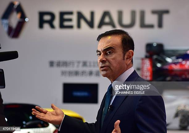 Chairman and CEO of Nissan and Renault Carlos Ghosn speaks during an interview at the 16th Shanghai International Automobile Industry Exhibition in...