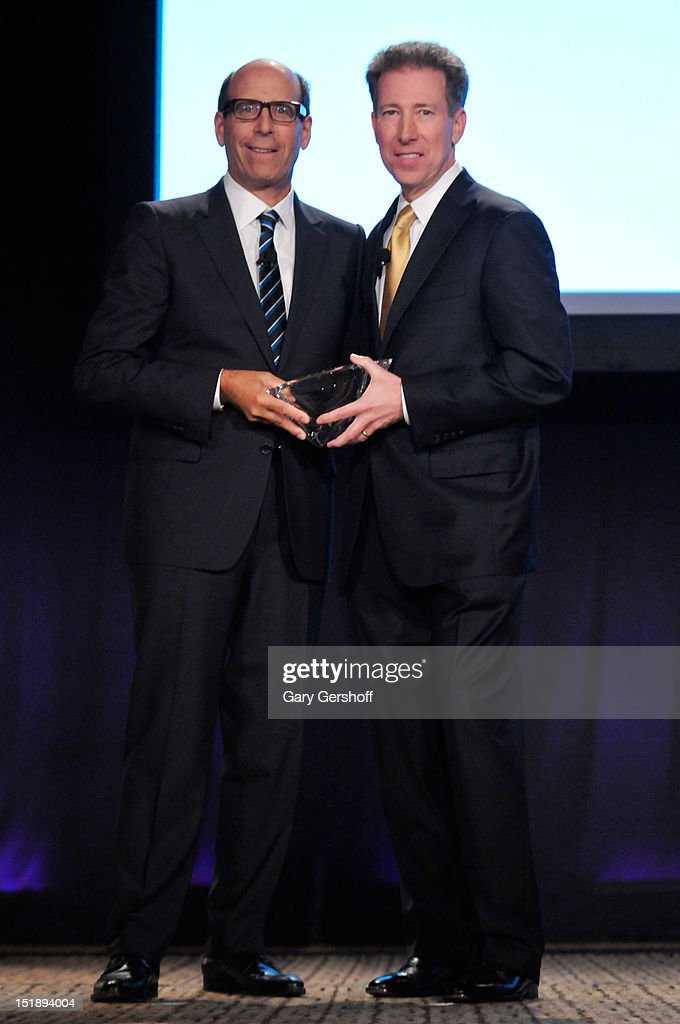 Chairman and CEO of Showtime Networks Inc. Matt Blank gives an award to President of Cox Communications Patrick Esser at the 29th Annual Walter Kaitz Foundation Fundraising Dinner at The Hilton Hotel on September 12, 2012 in New York City.