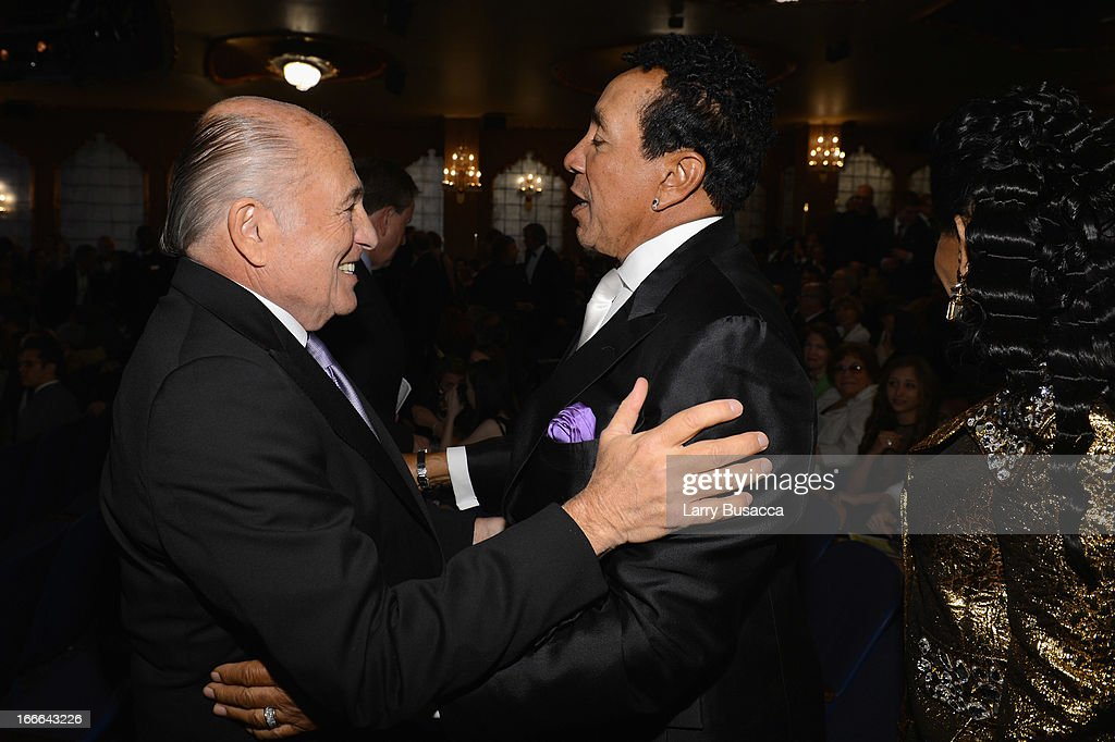 Chairman and CEO of Sony Music Entertainment <a gi-track='captionPersonalityLinkClicked' href=/galleries/search?phrase=Doug+Morris&family=editorial&specificpeople=830291 ng-click='$event.stopPropagation()'>Doug Morris</a> and performer and record producer <a gi-track='captionPersonalityLinkClicked' href=/galleries/search?phrase=Smokey+Robinson&family=editorial&specificpeople=210698 ng-click='$event.stopPropagation()'>Smokey Robinson</a> attend 'Motown: The Musical' Opening Night at Lunt-Fontanne Theatre on April 14, 2013 in New York City.