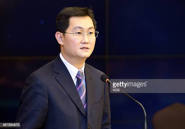 Chairman and CEO of Tencent 'Pony' Ma Huateng delivers a speech during the cooperation signing ceremony of Foxconn Tencent and China Harmony Auto on...