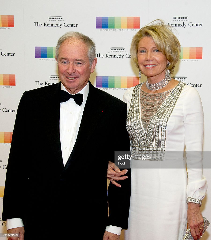 Chairman and CEO of the Blackstone Group Stephen A. Schwarzman and his wife, Christine, arrive for the formal Artist's Dinner honoring the recipients of the 39th Annual Kennedy Center Honors hosted by United States Secretary of State John F. Kerry at the U.S. Department of State on December 3, 2016 in Washington, D.C. The 2016 honorees are: Argentine pianist Martha Argerich; rock band the Eagles; screen and stage actor Al Pacino; gospel and blues singer Mavis Staples; and musician James Taylor.