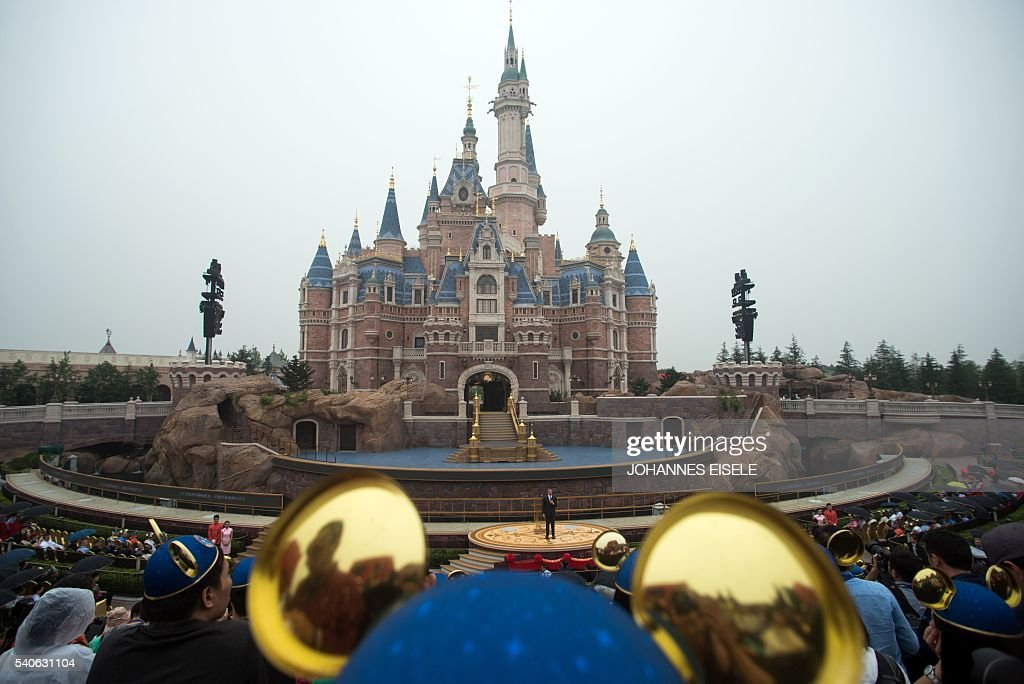 Chairman and CEO of Walt Disney Bob Iger delivers a speech in front of the Enchanted Storybook Castle during the opening ceremony of the Shanghai...