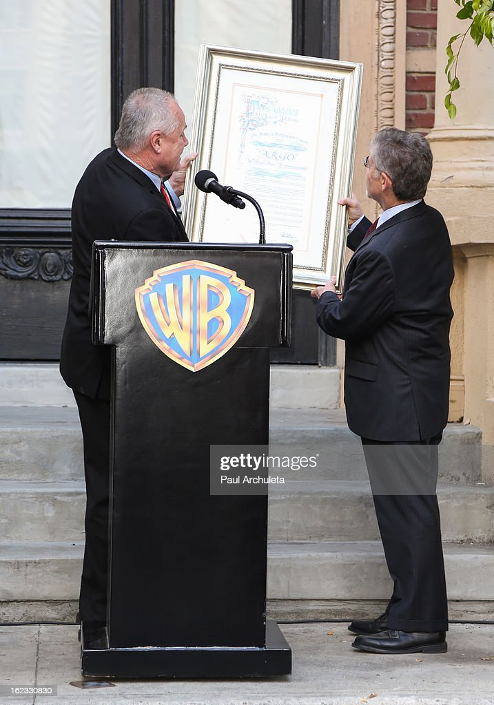 Chairman and CEO of Warner Bros. Entertainment Barry M. Meyer (R) and Los Angeles City Councilmen <a gi-track='captionPersonalityLinkClicked' href=/galleries/search?phrase=Tom+LaBonge&family=editorial&specificpeople=220711 ng-click='$event.stopPropagation()'>Tom LaBonge</a> (L) attend the presentation of the 2nd annual 'Made In Hollywood Award' to the crew of the Oscar nominated film 'Argo' at Warner Bros. Studios on February 21, 2013 in Burbank, California.