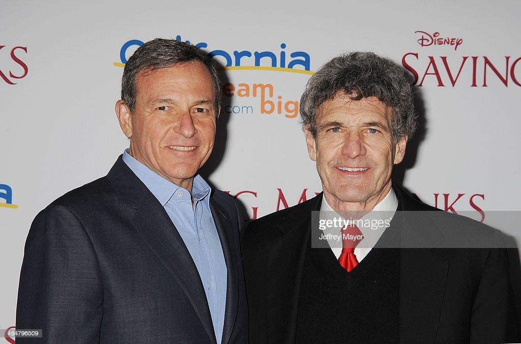 Chairman and CEO, The Walt Disney Company Bob Iger; (L) and Chairman of the Walt Disney Studios Alan Horn arrive at the 'Saving Mr. Banks' Los Angeles Premiere at Walt Disney Studios on December 9, 2013 in Burbank, California.