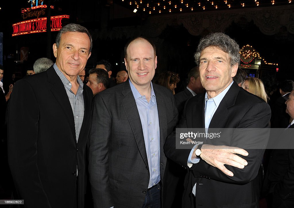 Chairman and chief executive of The Walt Disney Company <a gi-track='captionPersonalityLinkClicked' href=/galleries/search?phrase=Bob+Iger&family=editorial&specificpeople=171211 ng-click='$event.stopPropagation()'>Bob Iger</a>, President of Production at Marvel Studios <a gi-track='captionPersonalityLinkClicked' href=/galleries/search?phrase=Kevin+Feige&family=editorial&specificpeople=2262351 ng-click='$event.stopPropagation()'>Kevin Feige</a>, and chairman of the Walt Disney Studios <a gi-track='captionPersonalityLinkClicked' href=/galleries/search?phrase=Alan+Horn&family=editorial&specificpeople=213386 ng-click='$event.stopPropagation()'>Alan Horn</a> arrive at the premiere of Marvel's 'Thor: The Dark World' at the El Capitan Theatre on November 4, 2013 in Hollywood, California.