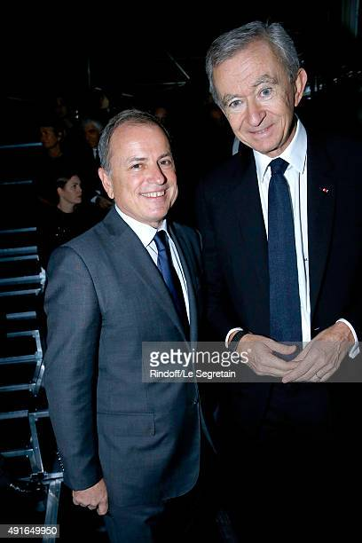 Chairman and Chief Executive Officer of Louis Vuitton Michael Burke and Owner of LVMH Luxury Group Bernard Arnault attend the Louis Vuitton show as...