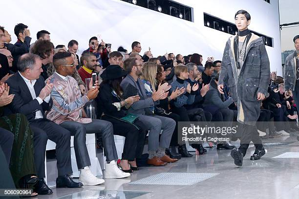 Chairman and Chief Executive Officer of Louis Vuitton Michael Burke Lewis Hamilton Guest Joel Edgerton Georgia May Jagger her sister Jade Jagger and...