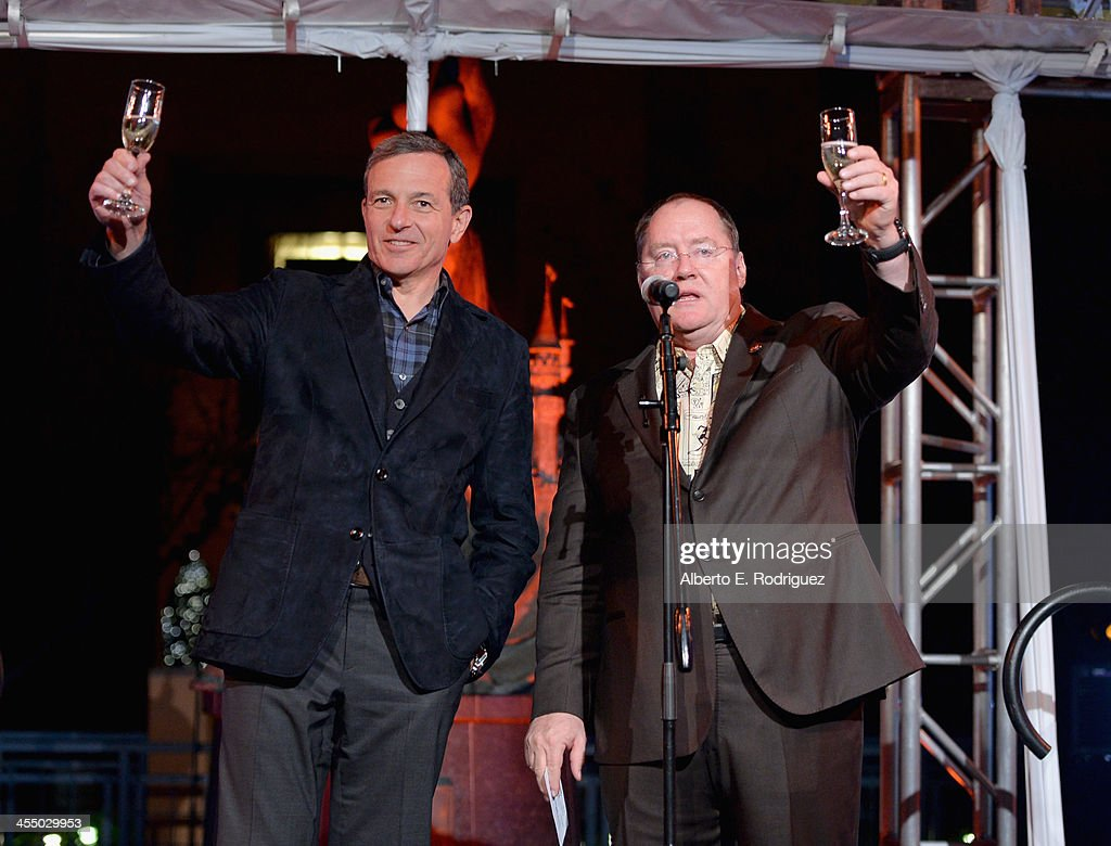 Chairman and Chief Executive Officer, The Walt Disney Company Bob Iger (L) and executive director John Lasseter speak onstage during the 90 Years of Disney Animation celebration at Walt Disney Studios on December 10, 2013 in Burbank, California.