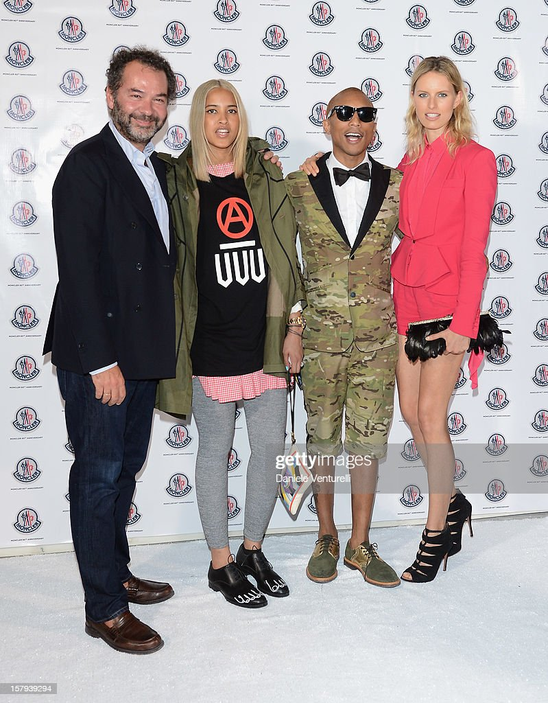 Chairman and Creative Director of Moncler Remo Ruffini, Helen Lasichanh, Pharrell Williams and Karolina Kurkova attend a private dinner celebrating Remo Ruffini and Moncler's 60th Anniversary during Art Basel Miami Beach on December 7, 2012 in Miami Beach, Florida.