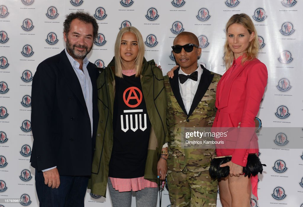 Chairman and Creative Director of Moncler Remo Ruffini, Helen Lasichanh, <a gi-track='captionPersonalityLinkClicked' href=/galleries/search?phrase=Pharrell+Williams&family=editorial&specificpeople=161396 ng-click='$event.stopPropagation()'>Pharrell Williams</a> and <a gi-track='captionPersonalityLinkClicked' href=/galleries/search?phrase=Karolina+Kurkova&family=editorial&specificpeople=202513 ng-click='$event.stopPropagation()'>Karolina Kurkova</a> attend a private dinner celebrating Remo Ruffini and Moncler's 60th Anniversary during Art Basel Miami Beach on December 7, 2012 in Miami Beach, Florida.