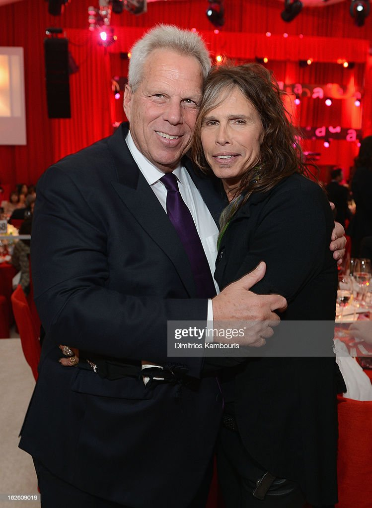 Chairman and Executive Vice President of the New York Giants Steve Tisch and singer Steven Tyler attend the 21st Annual Elton John AIDS Foundation Academy Awards Viewing Party at West Hollywood Park on February 24, 2013 in West Hollywood, California.