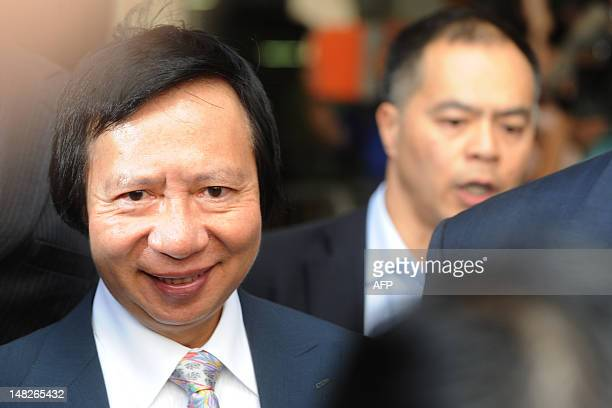 Chairman and Managing Director of Sun Hung Kai Properties Thomas Kwok smiles as he leaves a Hong Kong court after he was charged with corruption on...